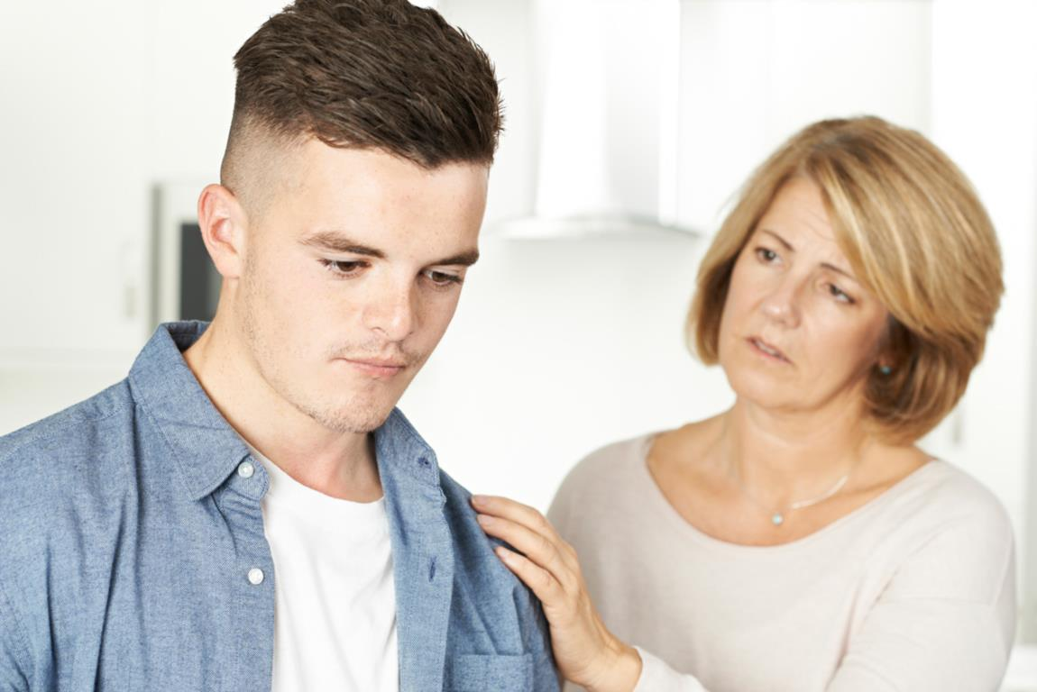 mother comforting son, gulf coast sexual assault program
